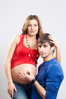 Man Show Ok Sign On Pregnant Belly Royalty Free Stock Images
