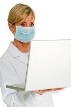 Free Female Doctor With Mask And Laptop Royalty Free Stock Images - 19046079
