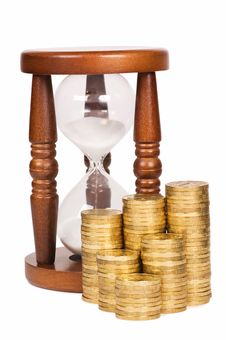 Hourglasses And Coin - Time And Money Concept Stock Photography