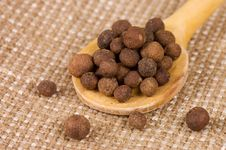 Fragrant Peppercorns On A Wooden Spoon Royalty Free Stock Photos