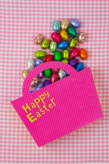 Free Chocolate Easter Eggs Falling From A Pink Bag Stock Image - 19049681