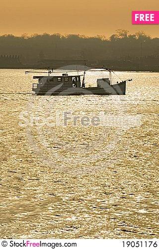Free Fishing Boat Trawling At Sunset Royalty Free Stock Image - 19051176
