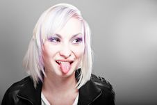 Blonde Teenager Girl Showing Tongue Stock Photo