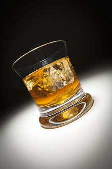 Free Glass Of Whiskey And Ice Under Spot Light. Stock Image - 19051451