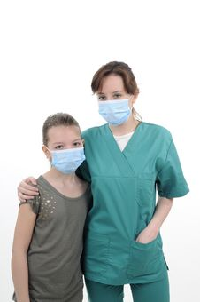Free Physician Posing With Teenager Stock Image - 19056871