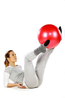 Free Girl Exercising With A Red Ball Between Her Legs Stock Images - 19059404