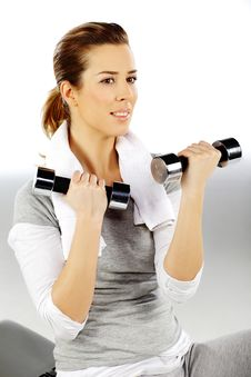 Free Girl Exercising With Weights, Closeup 3 Stock Photo - 19059450