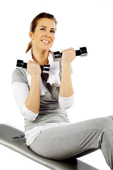 Free Girl Sitting Exercising With Weights Stock Image - 19059541