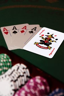 Four Aces And Joker In The Pack Stock Image