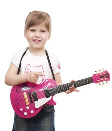 Free Little Girl Playing Toy Pink Electric Guitar Royalty Free Stock Image - 19062226