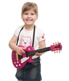 Free Little Girl Playing Toy Pink Electric Guitar Royalty Free Stock Photos - 19062238