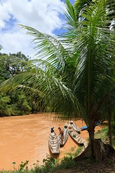 Brown River With Boats In The Jungle Stock Photo