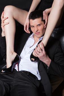Aggressive Man Embracing Woman S Legs Stock Photo