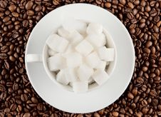 Coffee Cup With Beans And Lump Sugar Stock Photography