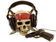 Free Skull In Ear-phones With A Lying Pistol Royalty Free Stock Photo - 19073615