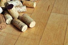 Free Corks On Maple Wood Floor Stock Photos - 19075563