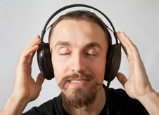 Free Young Man In Headphones With Closed Eyes Royalty Free Stock Images - 19078359
