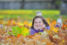 Free Little Girl Laying On Autumn Leaves Royalty Free Stock Image - 19082246