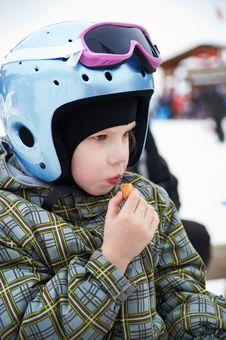 Free Little Girl In Ski Helmet Eats Sausage Stock Photos - 19084063