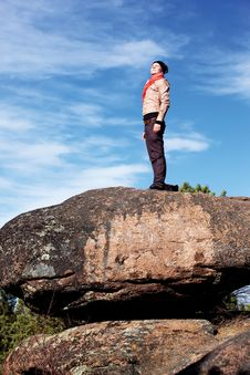 Free Girl On A Rock Royalty Free Stock Photography - 19085407