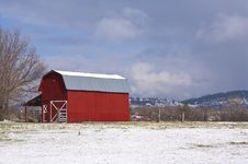 Red Barn, Blue Sky, White Snow. Royalty Free Stock Photo