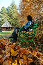 Free Woman On Bench In Park At Autumn Stock Photography - 19099052