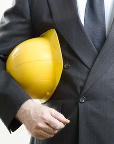 Construction Hat Under Arms Stock Images