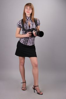 Free The Young Beautiful Girl With Camera In Hands Stock Images - 19091934