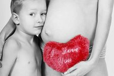 Boy And Pregnant Belly Royalty Free Stock Images