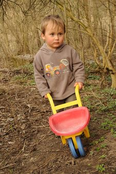 Boy With Wheelbarrow Royalty Free Stock Photo