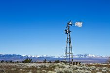 Free Broken-Down Windmill On Desert Farm Stock Photos - 19096073