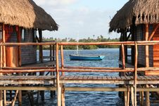 Free Hut And Boat In The Water Royalty Free Stock Photography - 19096957