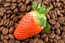 Coffee Beans With Bright Red Strawberry On Top Stock Photo