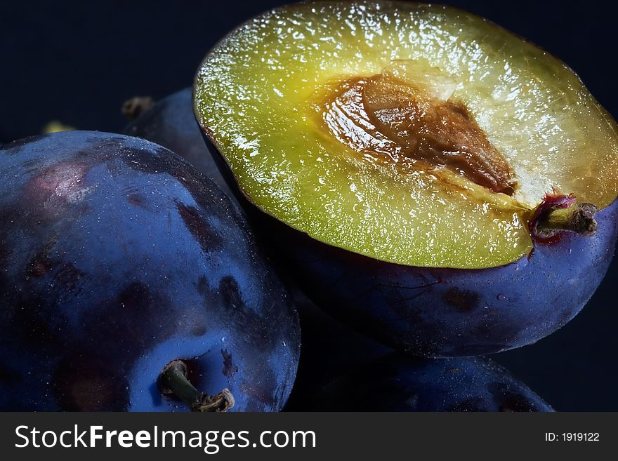 Dark blue ripe fleshy plums