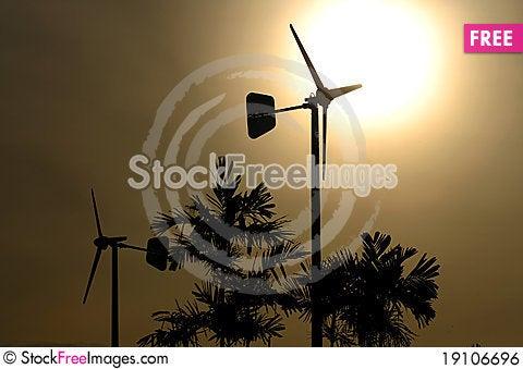 Wind turbine over sunset Stock Photo