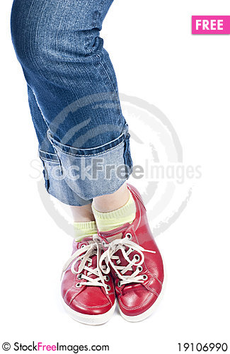 Woman Wearing Blue Jeans and Red Leather Shoes Stock Photo