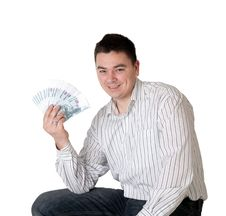 Happy Young Man Holding A Money Royalty Free Stock Image