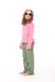 Free Young Girl Standing In Pink Top And Green Pants Stock Photography - 19104062