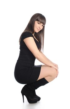 Free Cute Brunette In Black Dress And Boots Stock Photography - 19104762