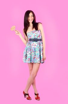 Free Glamorous Girl Wearing Colorful Dress With Lollipo Stock Photo - 19107540