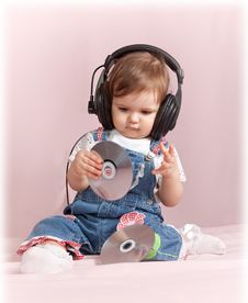 Free Child With CD Discs In Ear-phones Royalty Free Stock Photo - 19109145