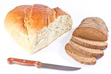 White Bread Loaf And Sliced Rye Loaf With Knife Royalty Free Stock Image