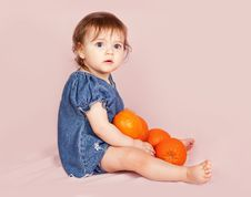 Free Little Beautiful Girl With Much Oranges Royalty Free Stock Photo - 19117965
