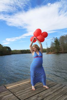 Pregnant Woman On The Dock 4 Stock Photos