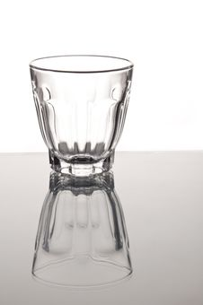 Empty Small Whisky Glass With Mirror Reflaction Royalty Free Stock Images
