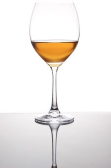 Wine In The Glass With Mirror Reflection Royalty Free Stock Photos