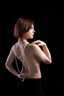 Woman With Naked Spine And Pearl Beads Stock Images