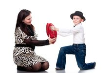 Cute Boy Giving Red Heart To His Mother Stock Photo