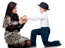 Cute Boy Giving A Present To His Mother Royalty Free Stock Image
