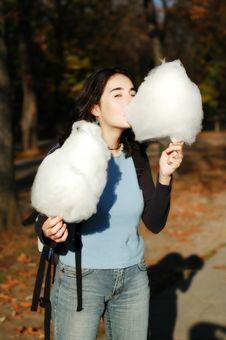 Girl Eating Cotton Candy Stock Photos